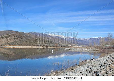 Mountains reflected in Deer Creek Reservoir, Utah