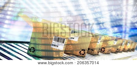 Row of brown boxes on conveyor belt against stocks and shares