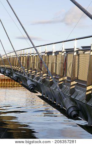 Vertical format of the Sail pedestrian footbridge over the River Tawe in Swansea Marina.