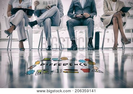 Difference text amidst various icons against group of well dressed business people waiting