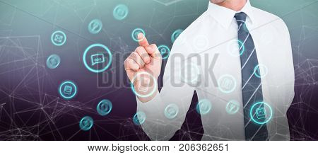 Businessman pointing with his finger against purple and blue background
