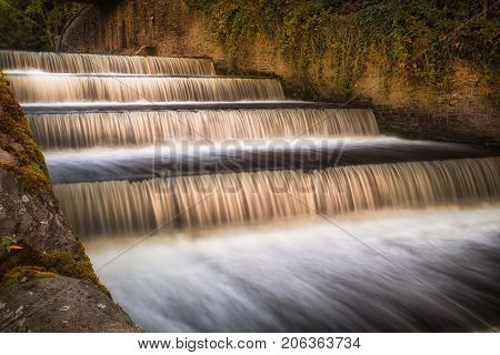 The spillway on the Lower Lliedi reservoir in Swiss Valley, Llanelli, South Wales UK