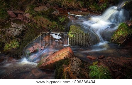 A stream in the Brecon Beacon mountains of South wales displaying the colours of Autumn