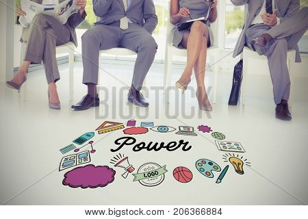 Multi colored power text surrounded by icons against business people sitting on chairs