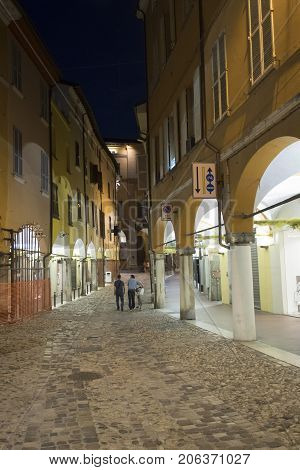 Cesena (Emilia Romagna Italy): old street with portico at evening