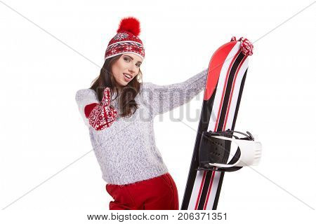 model wearing winter  suit holding a snowboard in studio