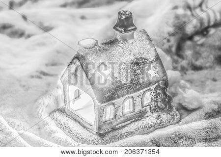 Bright christmas background with fairytale candlestick house. Christmas decoration.