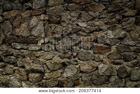 Brown stone wall. Stone background. Stone texture.Old stone style. Grunge stone. Grunge brown stone background.  Wall of the old fortification in Ust-Kamenogorsk.