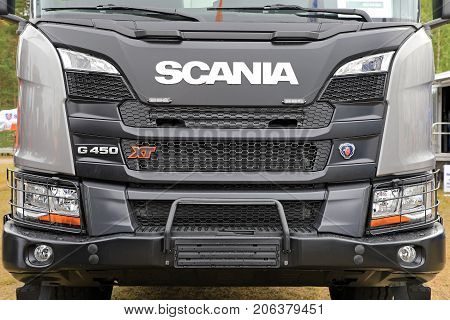 HYVINKAA FINLAND - SEPTEMBER 8, 2017: The front of Scania G500 XT truck featuring eg heavy duty bumper and headlamp protection mesh. Scania presents their new XT truck range on MAXPO 2017 Finland.