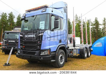 HYVINKAA FINLAND - SEPTEMBER 8 2017: Scania Suomi Oy presents the new Scania XT range R650 for wood transport and G450 for construction on Maxpo 2017.