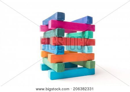 Close up photo of hight colorful chalks tower, isolated over white background