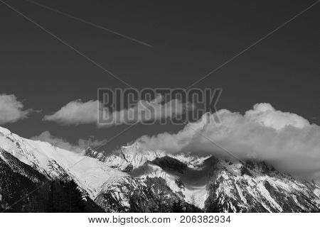 Cloud covered mountain peak in Austrian alps landscape black and white