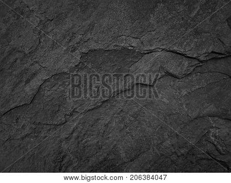Dark stone slate background or texture. black rock