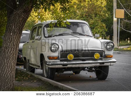 Old soviet car front view. Old car. Old white retro car. Retro style. Retro car fashion