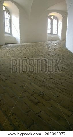 An internal view of the sloping cobblestone ramp inside the round tower in Copenhagen
