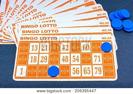 Stack of Bingo Lotto with Blue Markers at Play