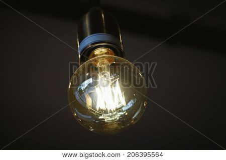 Vintage Edison Light Bulb In Coffee Shop