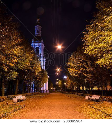 Night autumn view of illuminated St. Nicholas Naval Cathedral and alley in Nikolskiy garden St. Petersburg Russia