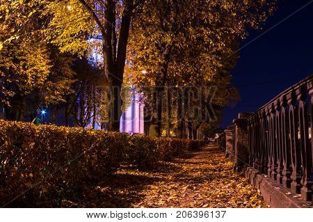 Night autumn low angle view of embankment of Kryukov Canal and illuminated St. Nicholas Naval Cathedral Saint Petersburg Russia