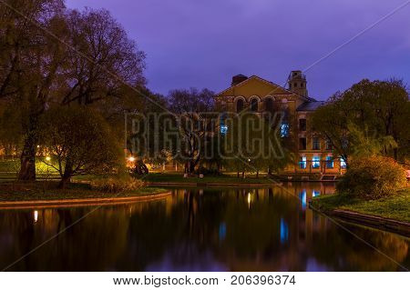 Dusk autumn view of park and pond in Yusupov Garden Saint Petersburg Russia