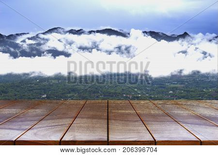 Empty wooden table space platform and Mountain and sky background for product display montage Wood table for product placement.