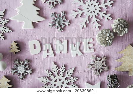 Letters Building German Danke Means Thank You. Many Christmas Decoration Like Tree, Star, Fir Cone And Snowflake. Flat Lay With Rose Wooden Background And Vintage Style