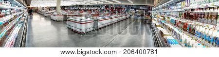 BANGKOK THAILAND - AUGUST 05: Refrigerated section of Macro superstore serves multiple unidentified customers on August 05 2017 in Bangkok.