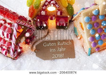 Label With German Text Guten Rutsch Ins Jahr 2018 Means Happy New Year 2018. Colorful Gingerbread House On Snow And Snowflakes. Christmas Card For Seasons Greetings