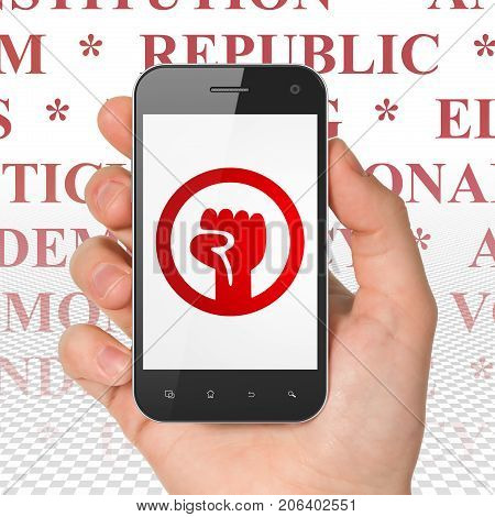 Political concept: Hand Holding Smartphone with  red Uprising icon on display,  Tag Cloud background, 3D rendering