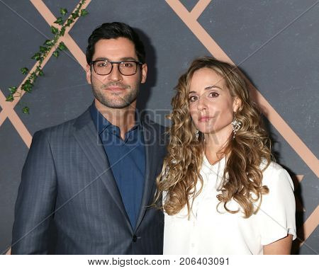LOS ANGELES - SEP 25:  Tom Ellis, Megan Oppenheimer at the FOX Fall Premiere Party 2017 at the Catch on September 25, 2017 in West Hollywood, CA