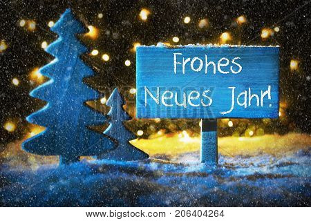 Sign With German Text Frohes Neues Jahr Means Happy New Year. Blue Christmas Tree With Snow And Magic Glowing Lights In Backround And Snowflakes. Card For Seasons Greetings.