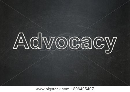 Law concept: text Advocacy on Black chalkboard background