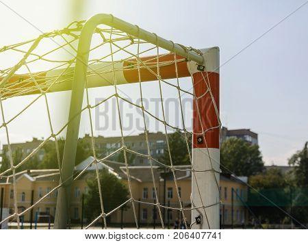 Gate for small football or handball in small stadium. Detail of gate frame. Outdoor football or handball playground.