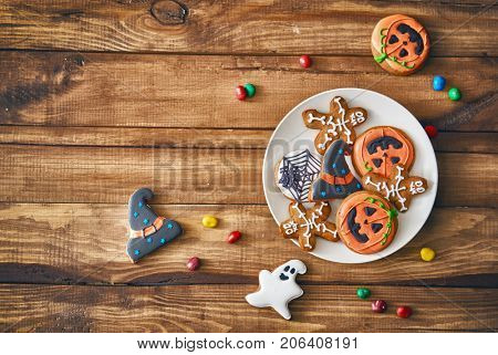 Happy Halloween! Sweets and cookies on the table in the home. Preparation for holiday.