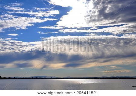 Sunshine over Lake Champlain on the border of Upstate New York and Vermont on Rouses Point Bridge, Vermont, USA.