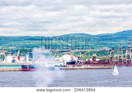 Cityscape And Skyline Of Quebec City With Saint Lawrence River And Industrial Port From Levis City,