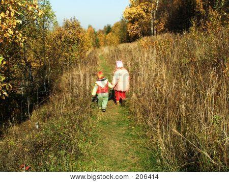 Children Going Into Autumn Forest