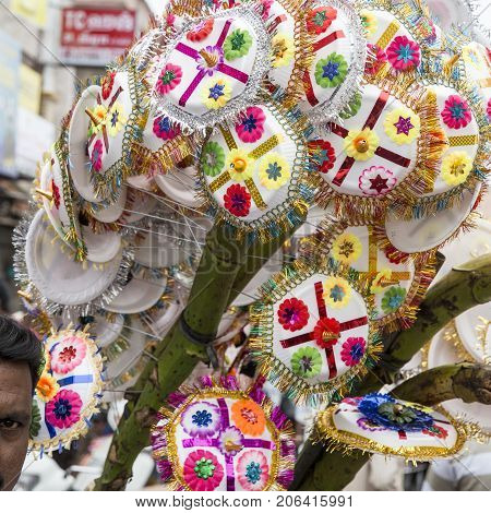 Vendor selling umbrella for devotees to bless Hindu god Ganesh at local market on the first day of Ganesh Chaturathi festival