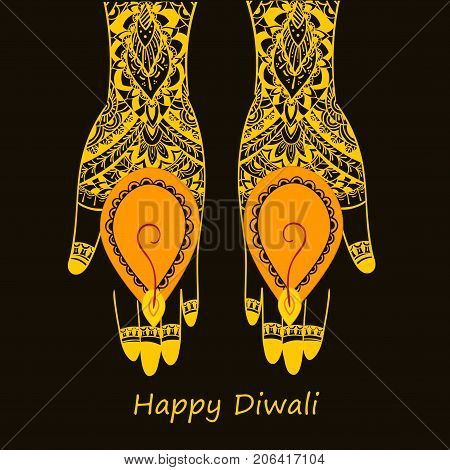 Hands with mihandy art holding Indian oil lamp - diya, Happy Diwali festival, Happy Diwali text