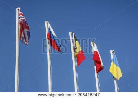 Numerous flags of states on blue sky background