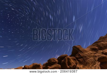 Night Sky With Star Trails Circular Motion In Goblin Valley State Park In Utah Showing Red Canyons L