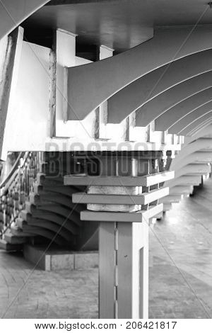 Black and white photo fragment of architecture with lots of repetitions in turns