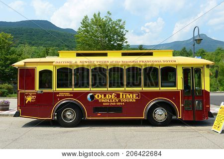 WHITE MOUNTAINS - JUL. 12, 2015: Olde Time Trolley Tours of Loon Mountain in White Mountain National Forest, White Mountains, New Hampshire, USA.