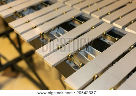 xylophone, musical chromatic instrument concept - closeup on glockenspiel, beige wooden bars without mallets, marimba, balafon, semantron, pixiphone, education and orchestra concert usage