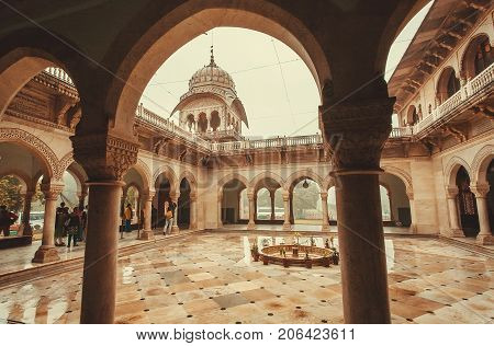 JAIPUR, INDIA - JAN 22, 2016: frame of arch and courtyard of historical Albert Hall Museum with stone columns on January 22, 2016. Indo-Saracenic architecture building was opened in 1887.