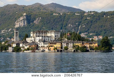 Panoramic view of San Giulio Island in the middle of Orta Lake Piedmont Italy.