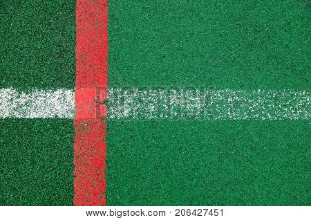 A close-up is a specialized outdoor sports ground covering a rubber crumb of green color with marked lines for playing sports. View from above