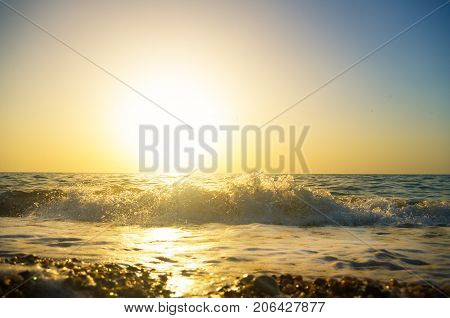 Sunset on the beach in summer. Photo from the lower angle.