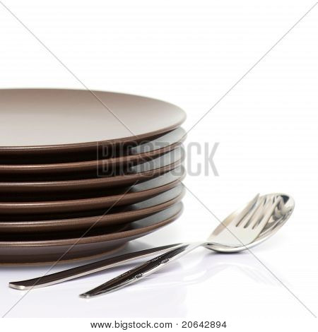 Stack Of Brown Round Plates