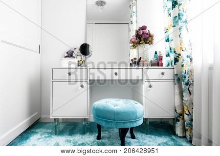 Modern White, Feminine Dressing Room With Minimalist Vanity Table And Mirror